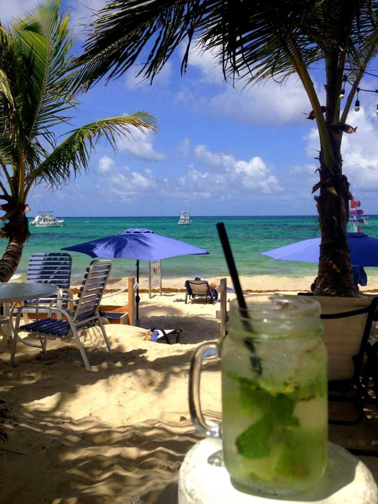 Having a cocktail at El Cortecito Beach in Bavaro, Punta Cana