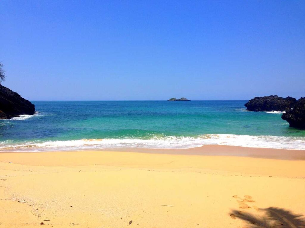 Playa Onda Samana, a remote and pristine beach on the Samaná peninsula, accessible by hike or boat only